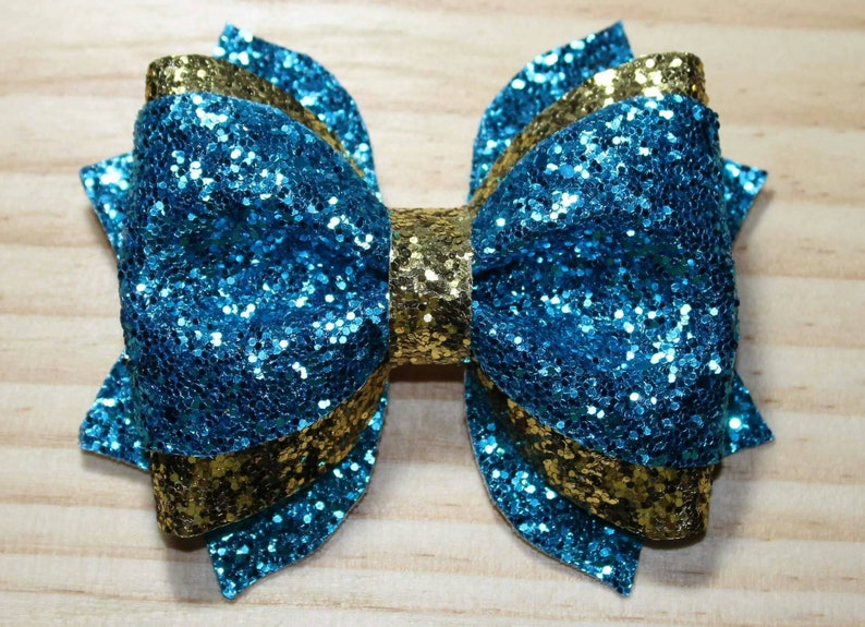 Sparkly aqua and gold glitter layered hairbow clip. image 0