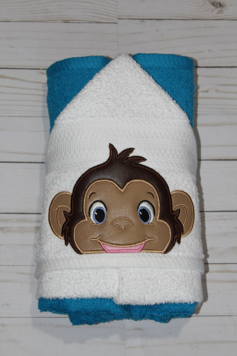 Handcrafted machine embroidered monkey face hooded towel. image 0
