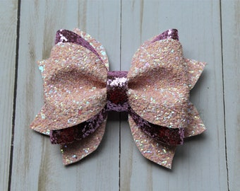 Pink sparkle glitter layered hairbow clip.