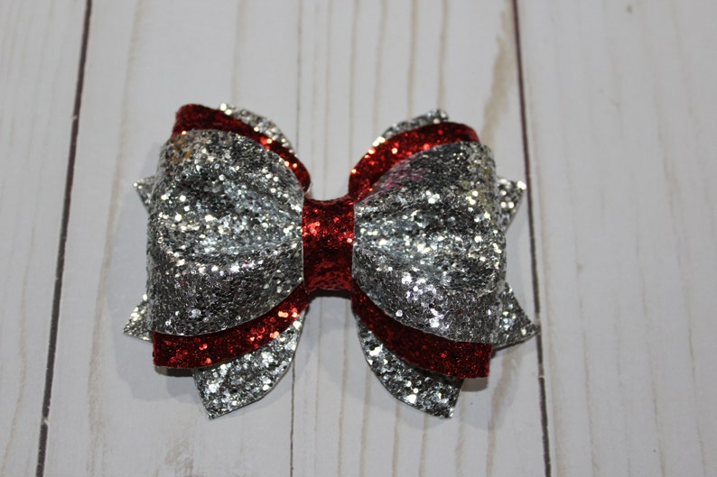 Sparkly red and silver glitter layered hairbow clip. image 0
