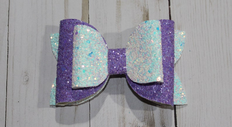 Sparkly purple and white glitter layered hairbow clip. image 0