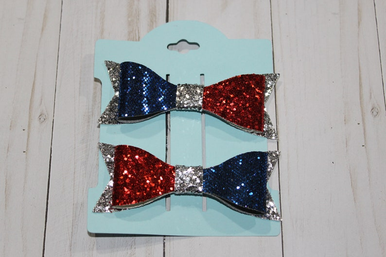 Set of 2 small blue red and silver glitter layered hairbow image 0