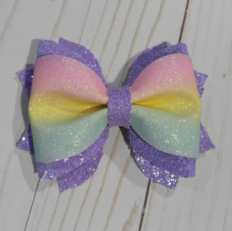 Sparkly purple and rainbow layered hairbow clip. image 0