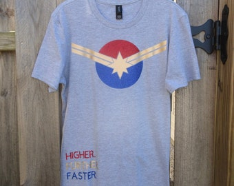 f7006614923 Captain Marvel Inspired- Higher Further Faster Tee