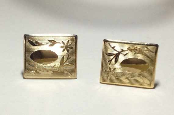 Vintage 1960s gold tone cuff links; vine flower and shield design; classic and elegant; perfect Father\u2019s Day gift