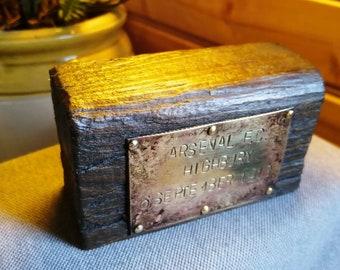 ARSENAL FC, HIGHBURY. A brass and wooden souvenir.