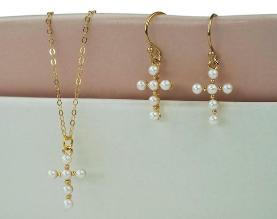 Samira Cross Pendant. White Beads and Gold Plated Brass.