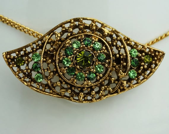 Vintage Eye Ellen Brooch. Rhinestones and Gold Plated Metal Work.