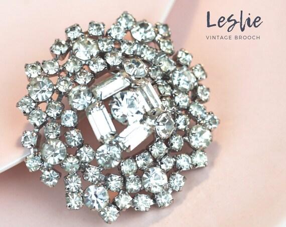 Vintage Leslie Brooch. Rhinestones and Silver Plating.