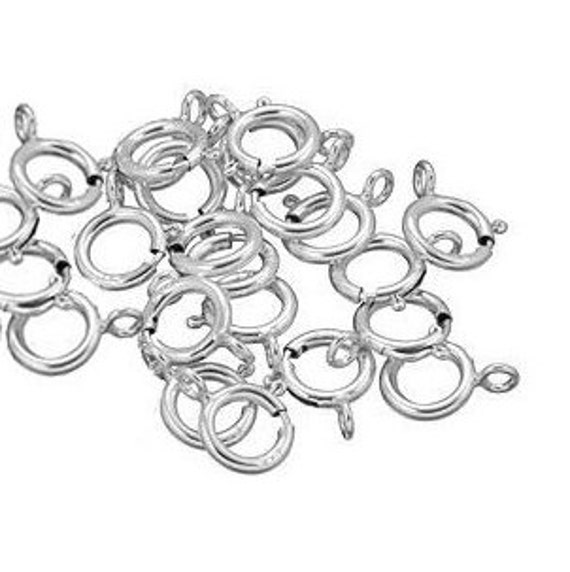 10 Robyn Spring Ring Clasps. Sterling Silver.