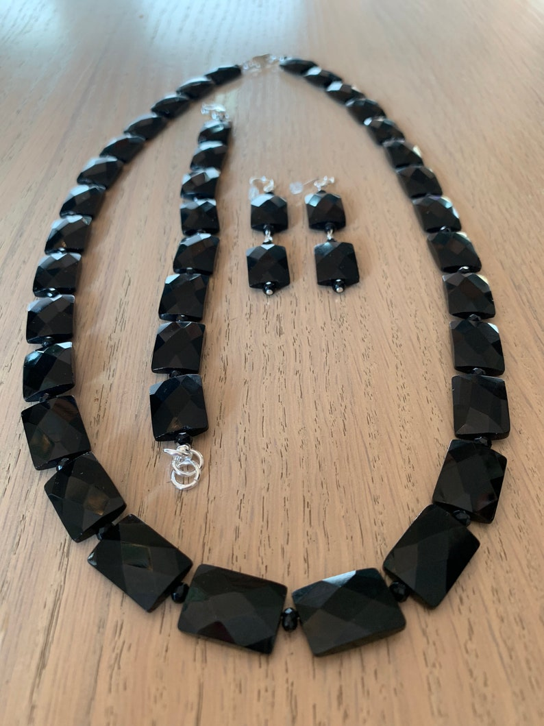 Faceted flat rectangle and Rondelle onyx beads with bracelet and earrings set