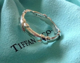 abe2c93e3 Tiffany & Co. Sterling Silver Signature Kiss Band Ring