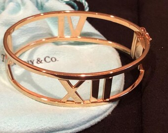 91f6264ab Tiffany & Co. 18K YG Atlas Roman Numeral Bangle Bracelet