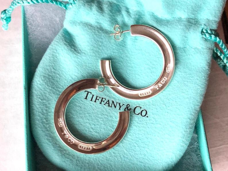 4bc0ed3615fb7 Tiffany & Co. Sterling Silver T CO 1837 Hoop Earrings