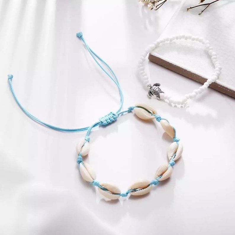 blue /&  white beads with  a tiny turtle and white shells with blue adjustable twine. Pair of anklets or bracelets,Ladies,Teenagers or Girls