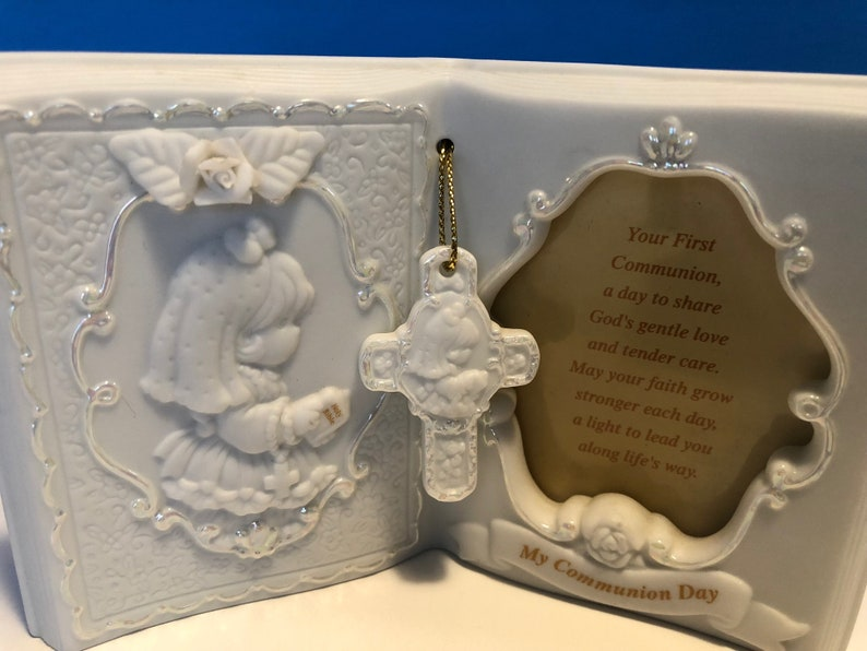 Precious Moments First Communion Keepsake Beautifully detailed image of a girl holding a Bible ready to receive her First Holy Communion.