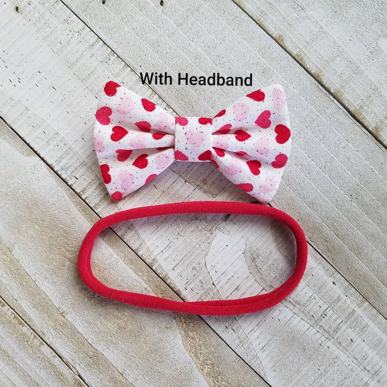 Infant Valentines Hair Bow with Hearts Skinny Nylon Headband or Clip Newborn Valentines Bow with Pink and Red Hearts and a touch of Glitter