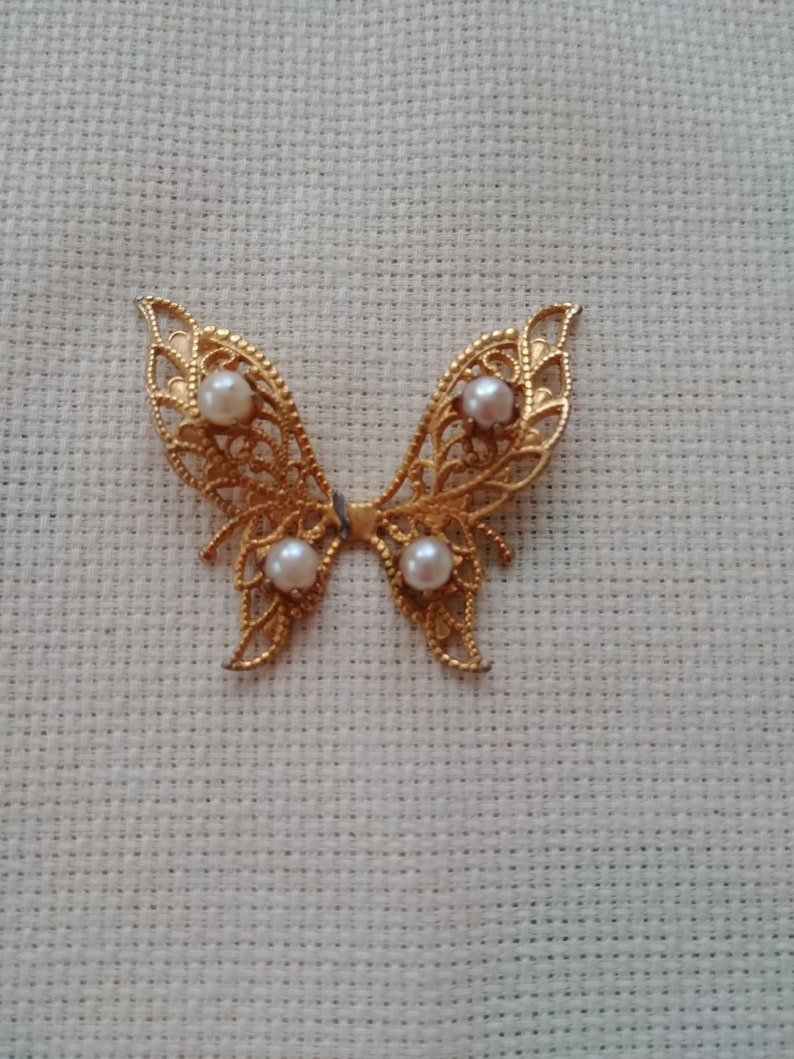 Needle Minder Medium Golden Metal Butterfly with Faux Pearls On The Wings and is Magnetic