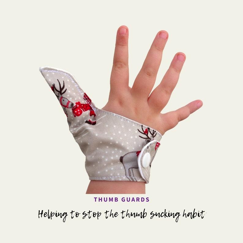 Christmas thumb Guard 2 pack. Festive thumb glove thumb image 0