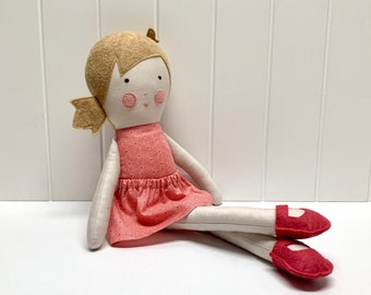 Blonde-haired girl doll with coral pink dress, handmade, fabric toy for children