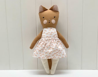 Orange cat with rainbow patterned dress, handmade, children's toy made of fabric.