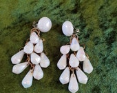 Earings, chandelier style clip on. 1960 39 s, goldtone rings with white faceted beads, with mother of pearl effect.