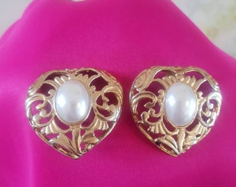 Earings 1980's clip on. Ornate goldtone in a heart design,  with a faux pearl centre.