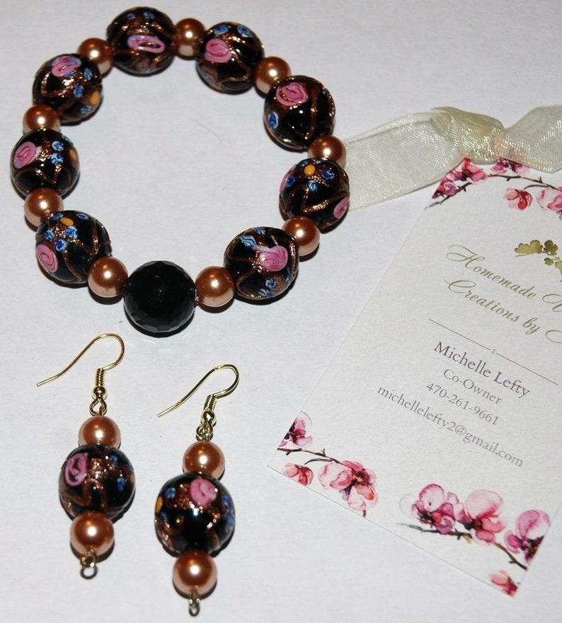 bronze and pink flower set Black