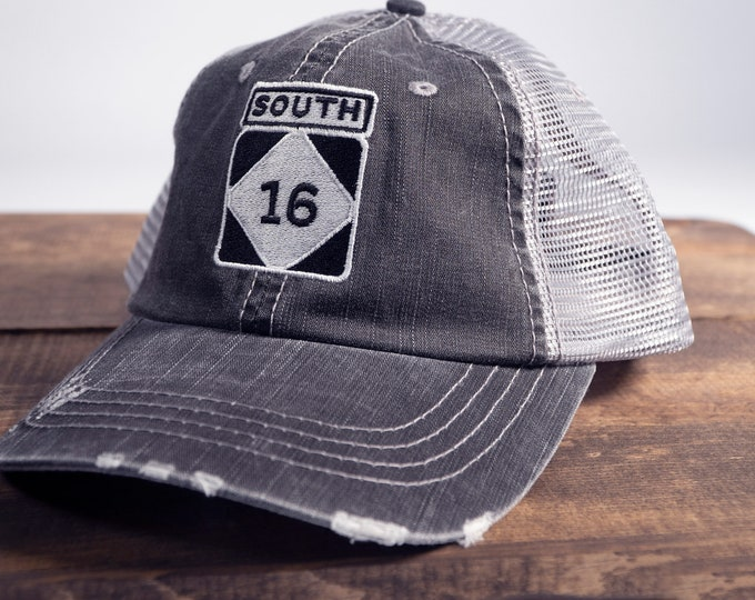 Highway 16 (where the road ends) Distressed Trucker Hat