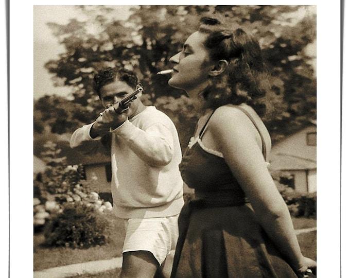 Vintage photo handmade Polaroid style photo Shotgun Cigarette 1940's weird art man shotgun aiming at cigarette in woman's mouth