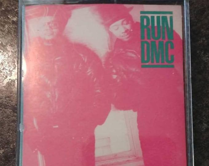 Run DMC Raising Hell cassette tape 1986 Profile Records Canadian version cassette tape Polygram Inc. Rap Hip Hop D.M.C.