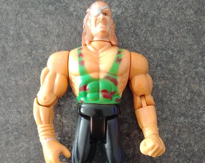 Hard to find WWE WWF Jakks Snake eye patch Knock Off figure funny KO action figure wrestling 1990's