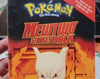Pokemon The First Movie Mewtwo Strikes Back movie book Scholastic books first print 1999 Nintendo HTF kids novelization