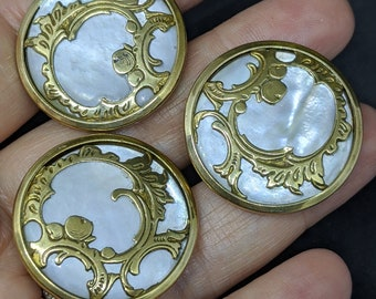 ornate gilt cased mother of pearl button