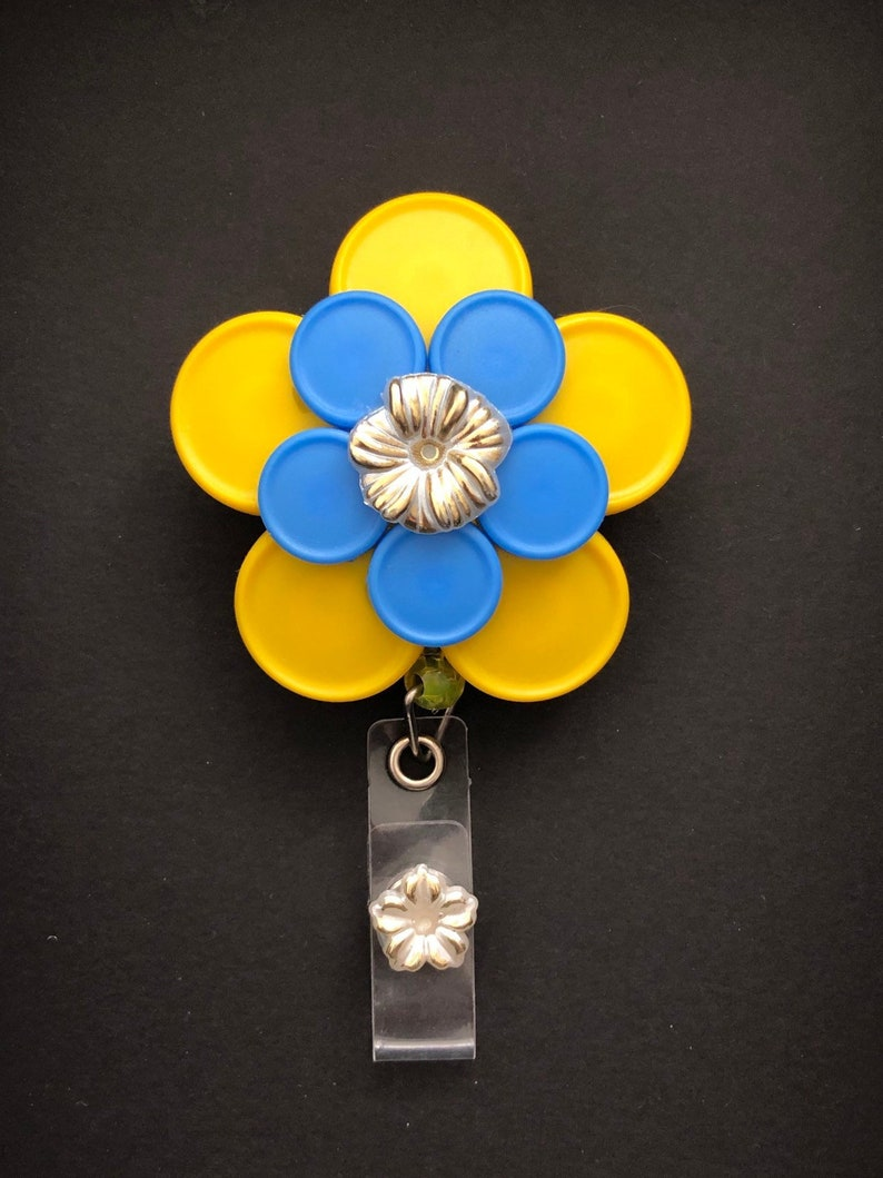 Rebecca 10 petal Yellow and Blue Flower with Gold Flower Cabachon Med Cap Vial Badge Reel