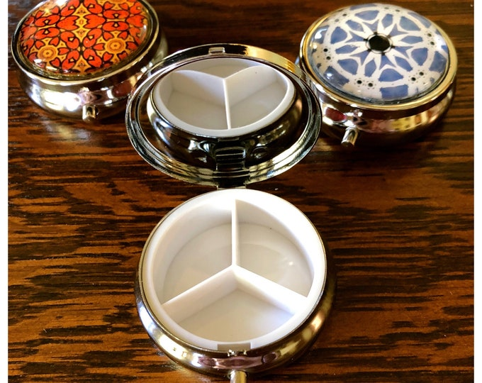 Pill Boxes with Vivid, Original Designs Set on Stainless Steel Base, Functional and Fabulous