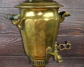 Vintage Old Soviet Samovar on the wood of his imperial majesty the heir to Batashev