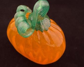 Orange windowsill skinny glass pumpkin