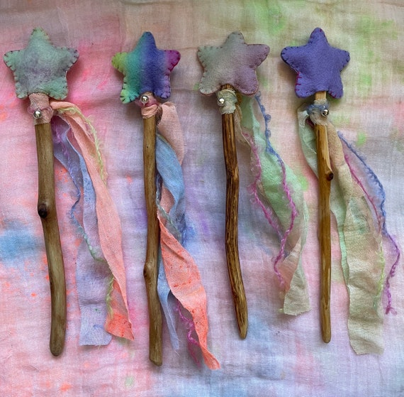 Star Fairy Wand. Natural Materials. Hand dyed felt, muslin, hand spun yarn. Locally Foraged Wood. Jingle Bell.