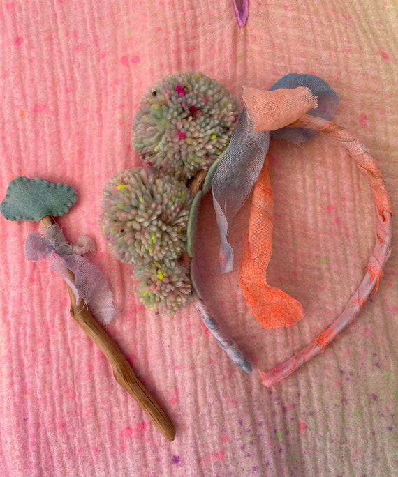 Triple Pom Pom headband with jingle bell and muslin ribbon. All hand dyed natural fibres. Pastel Rainbow.