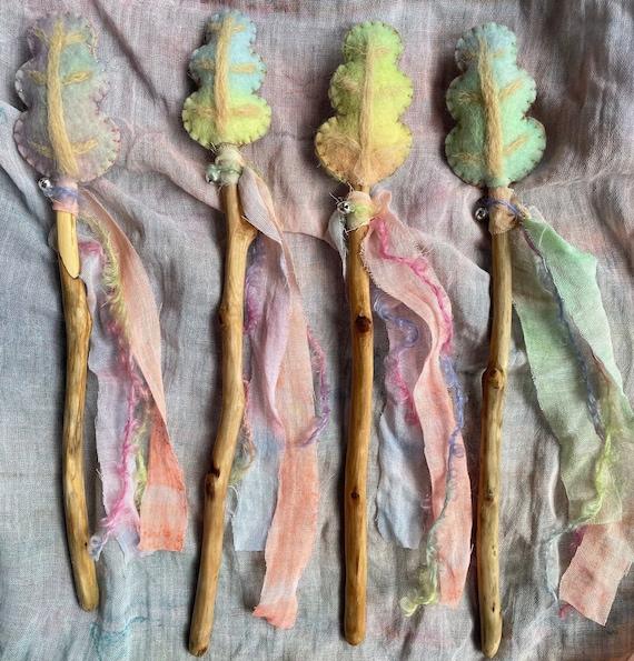 Leaf Fairy Wand. Natural Materials. Hand dyed felt. Hand spun yarn. Jingle bells. Pastel Rainbow.