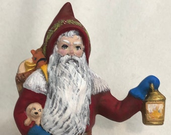 Old Time Santa with Puppies and Lantern Ceramic Art