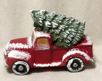 Classic Red Pickup Truck with Tree and Snow