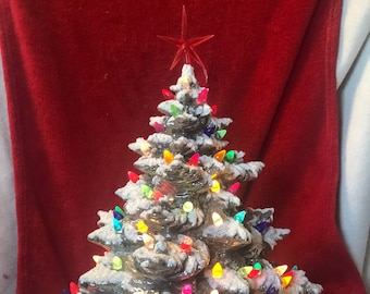 Silver and Mother of Pearl Glazed Ceramic Frazier Fir with multicolor bulbs, blue star and base by jmdceramicsart