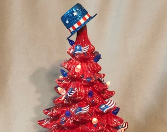 Red Glazed Ceramic Independence Day Tree with blue and white flecks, bulbs, stars and interchangeable star and hat with light pack
