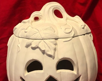 Large Ceramic Pumpkin with face cut out and lid in bisque ready to paint