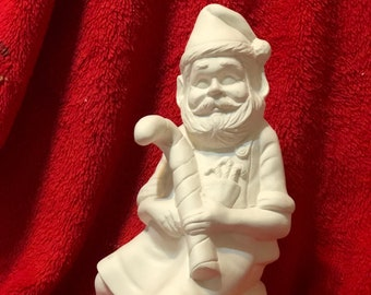 Ceramic Christmas Elf on a Barrel in bisque ready to paint