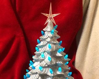Silver Metallic Medium Doc Holiday Ceramic Christmas Tree with Aqua bulbs, Iridescent star and base
