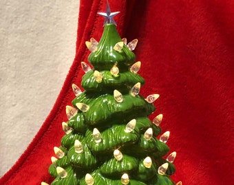 Glazed Spotted Kiwi Ceramic Tree with clear bulbs, light blue star, white base and light kit