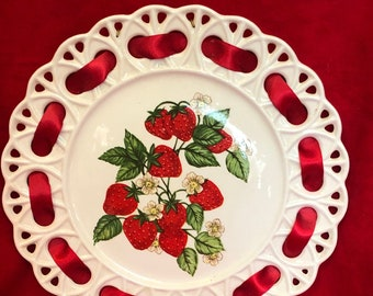Glazed decorative plate with red ribbon and strawberry decals